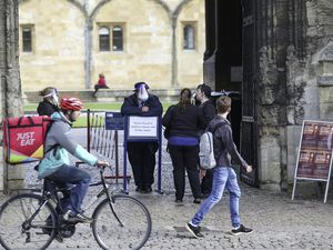 Staff at Christ Church university wear face masks in Oxford. A new three-tier system of alert levels for England has been implemented following rising coronavirus cases and hospital admissions. (28824315)