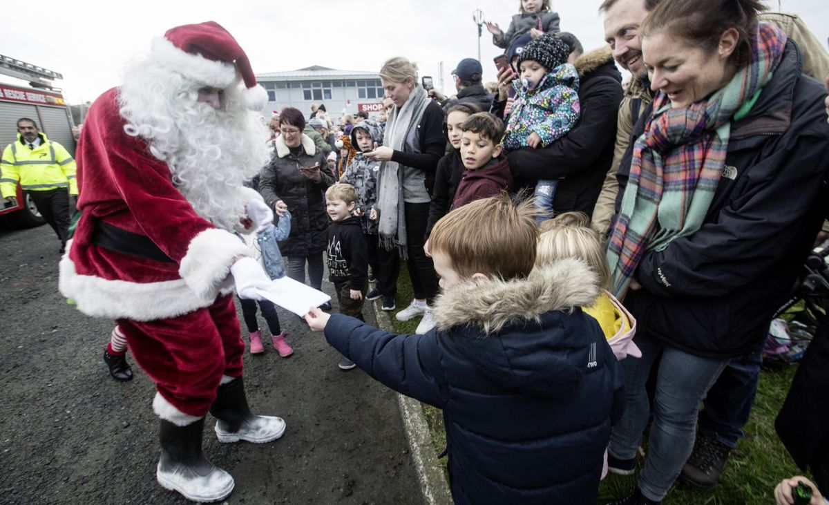 Santa accepts a child's Christmas list having arrived at the Model Yacht Pond before making his way to Market Square. (Picture by Adrian Miller, 28937290)