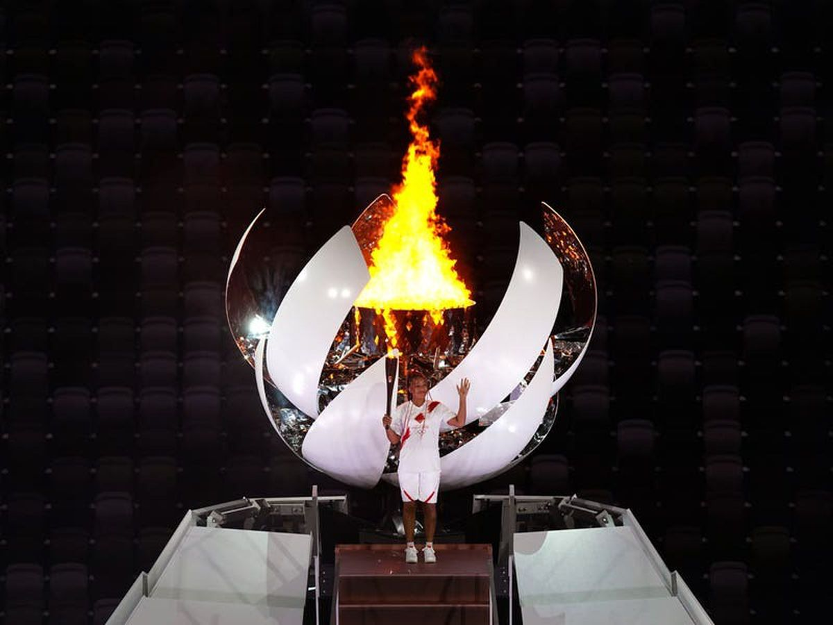 Naomi Osaka lights Olympic flame after understated opening ceremony in Tokyo