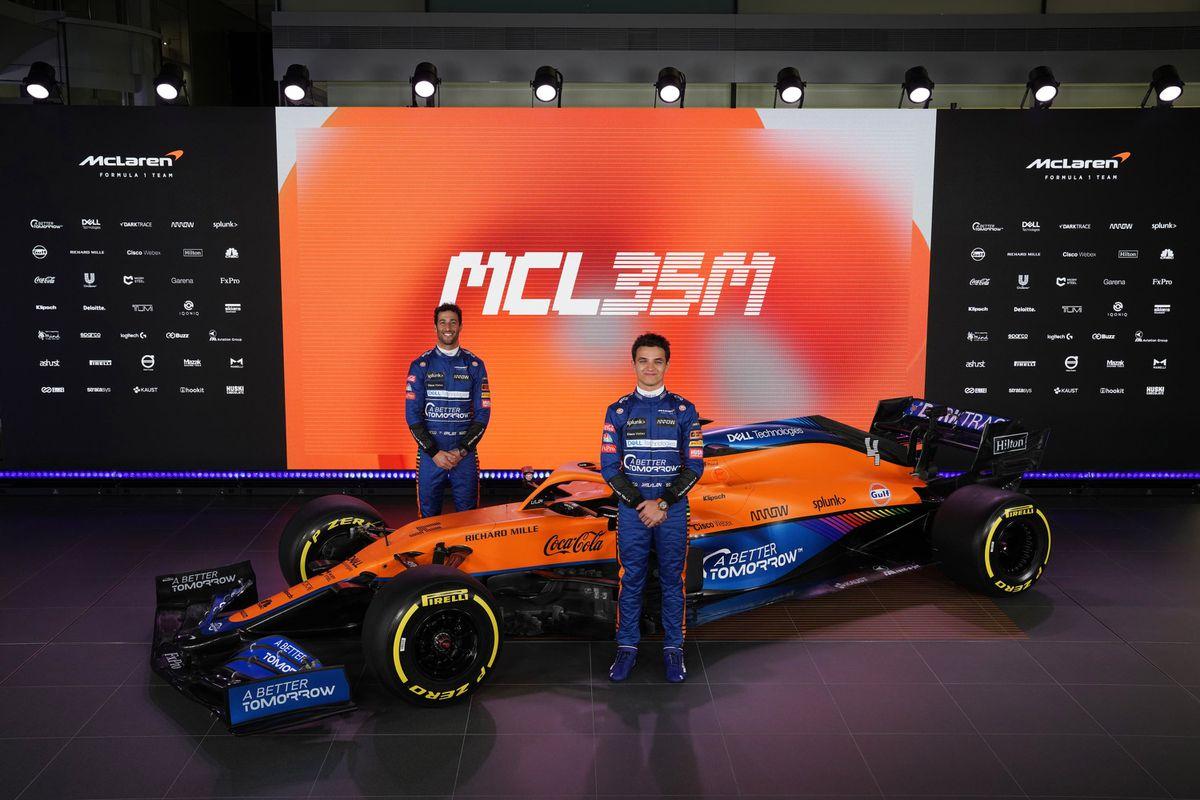 Drivers Lando Norris, right, and Daniel Ricciardo at the unveiling of the McLaren car for the 2021 F1 season. (McLaren F1/PA).