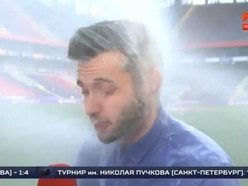 Watch: Sprinkler hoses Russian journalist in face during live sports report