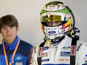 Looking for tips: Seb Priaulx watches his father Andy preparing to drive for Ford Chip Ganassi racing team at the Six Hours of Silverstone. (Picture by Drew Gibson Photography, 22316149)
