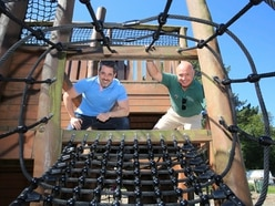 Volunteers jump to it as park playground reopens