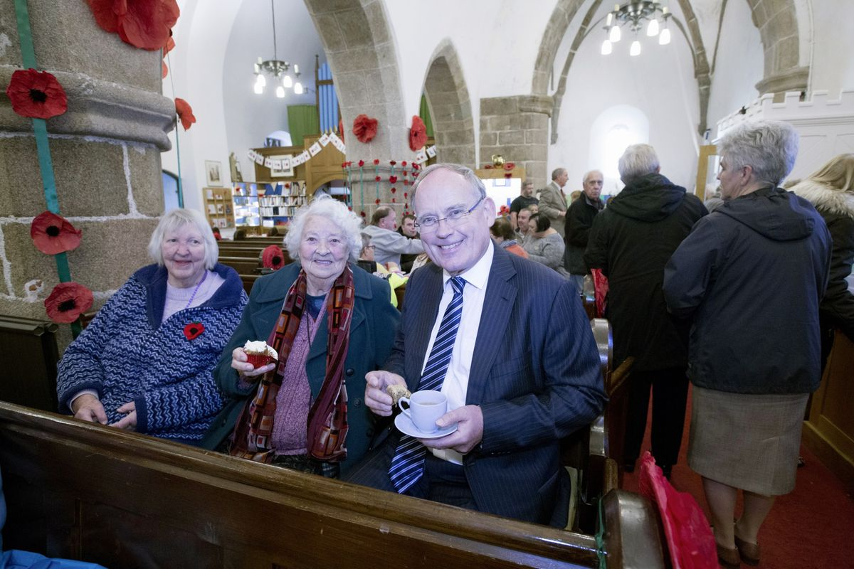 Former Bailiff Sir Richard Collas with Sue de Garis, left, and Enid Guille at the St Saviour's Church Remembrance tea party. (Picture by Adrian Miller, 28881674)