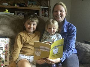 Doctor Mel Broadurst-Allen with her five-year-old son Sandy and his 22-month-old sister reading her book.
