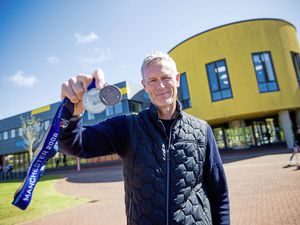 Olympic swimmer and former world record holder Mark Foster took some of his many medals when he gave a talk at St Sampson's High School. (Pictures by Peter Frankland, 24569600)