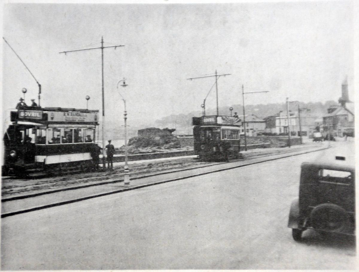 Trams travelling along Les Banques, near the Red Lion, on their way from St Peter Port to St Sampson's, and back. (28697275)