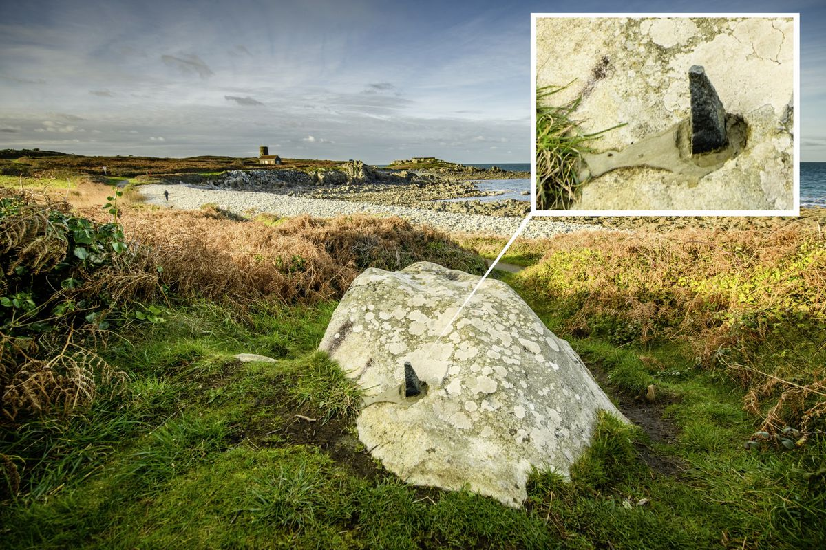 When Nick Despres went to take pictures of Le Pied du Boeuf he discovered someone had poured concrete and put a stone into it. Both have been removed.