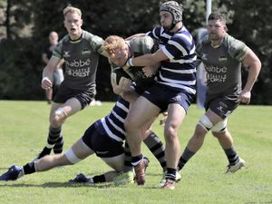 Raiders centre Matt Armstrong gets wrapped up in the tackle by two Westcombe Park opponents. (Picture by Mike Marshall, 29875416)