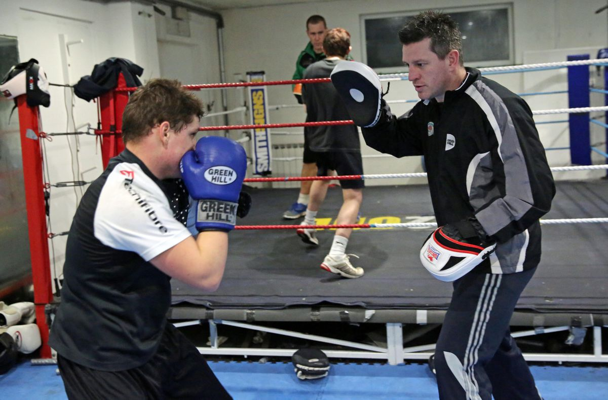 Head coach Ben Duff (right) with young Niall Adams on the 'pads' which is currently not permitted in the UK clubs. (28764860)