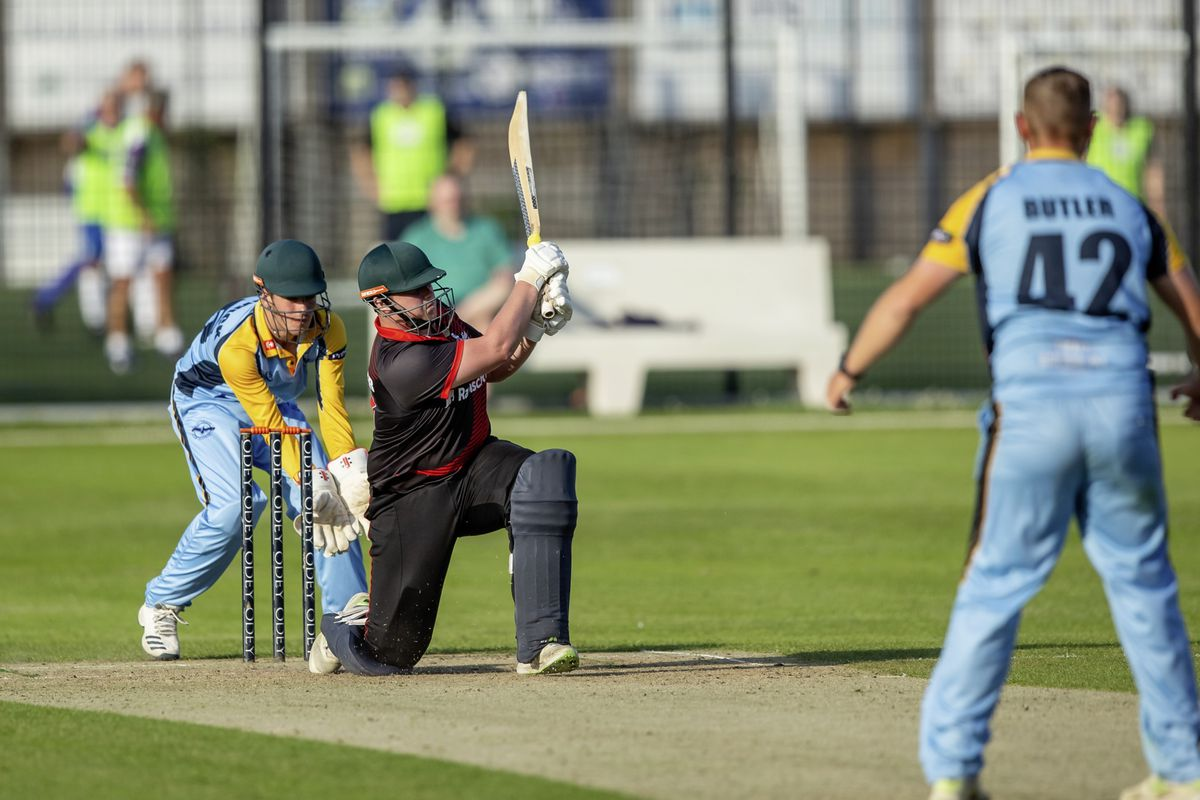 Independents captain Nathan Le Tissier slog-sweeps his opposite number, Josh Butler at KGV last evening. (Picture by Martin Gray, www.guernseysportphotography.com, 29784038)
