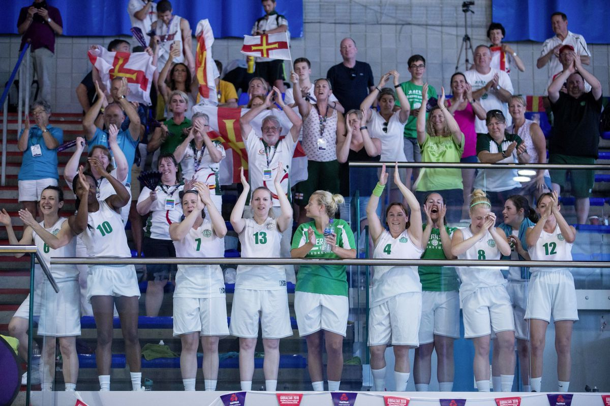 Green army support for the men's game including from the Guernsey women's team, who had just beaten Jersey 52-14 on the neighbouring court. (Picture by Peter Frankland, 25194804)
