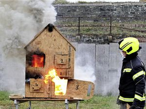 Alderney Voluntary Fire Brigade have been training with a Palmer's fire behaviour dolls' house. Picture by David Nash. (29617422)