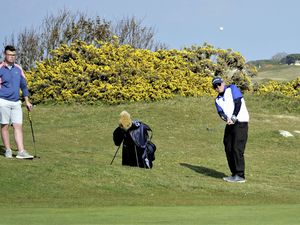 GOLF Guernsey Press Elite Men's Foursomes Championship qualifying round at L'Ancresse. Arthur Evans chips watched by playing partner Ollie Chedhomme.Picture by Gareth Le Prevost, 01-05-21. (29501643)