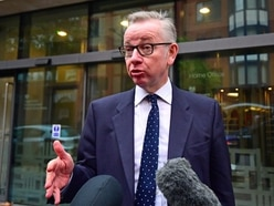 Beleaguered May thrown a lifeline as Gove stays in Cabinet