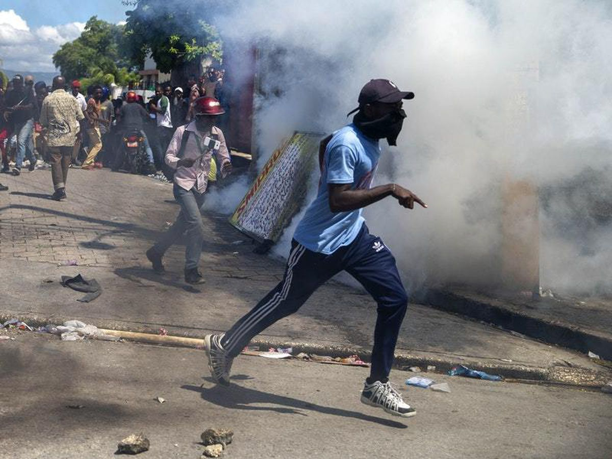 Police in Haiti use tear gas and rubber bullets to disperse protesters