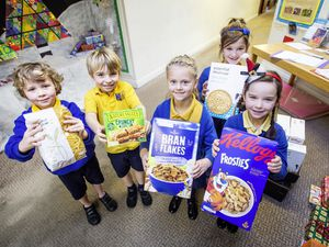 Picture by Sophie Rabey.  09-12-19.  St Martins Primary School have been doing a 'reverse' advent.  Children have been bringing in food to make up hampers which are sent out to the community.  L-R Henry Amory (6), Charlie Dowding (6), Tilly Colley (6), Tiana Crowson(7), Flo Cook (6).. (26602647)