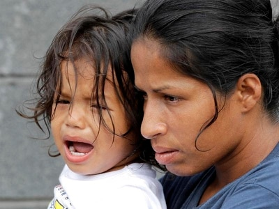 Uncertainty and tears for migrants caught in US border chaos