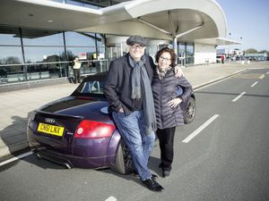 Steve Lines, with wife Coral, was one of only six passengers on Saturday's Blue Islands flight. He is returning to the UK airport on the day before the service is suspended.  (Picture by Adrian Miller, 26925456)
