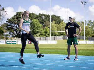 Picture by Sophie Rabey.  17-05-20.  Guernsey Athletics are being able to introduce 1 to 1 training again as Coronavirus Lockdown regulations have been relaxed further.  Tom Druce coaching sprinter, Abi Galpin. (28278976)