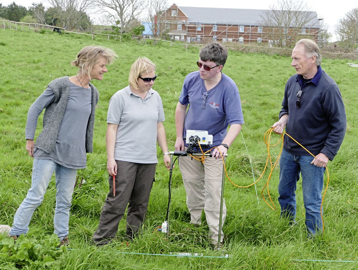 A pievce of equipment which measures resistivity has been used to survey a site in Alderney where Iron Age and Roman remains were found. The machine is being operated by Alderney volunteers Nick Hogben and Mike Deane. Also pictured are Guernsey Museums assistant archaeologist Tanya Walls, left, and Louise Randell.(Picture by David Nash)