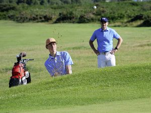 GOLF Nedgroup Scratch League - Rocque Balan Royals v LGM Douit Dodgers at L'Ancresse. Daniel Troop splashes out of a bunker watched by foursomes partner Andy Dawson.Picture by Gareth Le Prevost, 19-07-21. (29781983)