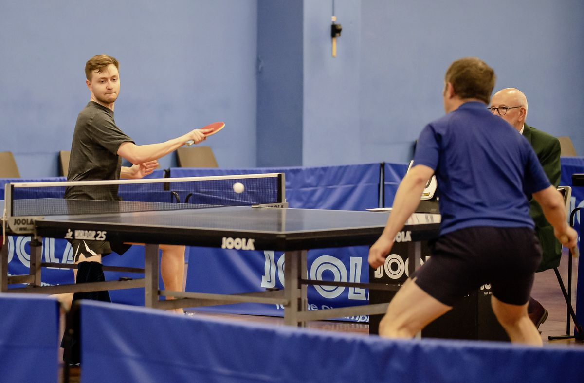 Josh Stacey goes on the attack against Phil Ogier in the men's singles final. (Picture by Andrew Le Poidevin, 29502194)