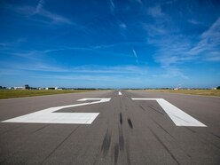 Business community cautious over runway extension report