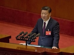 Chinese president urges stronger stand against 'grim' challenges