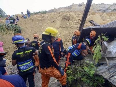 Dozens of houses buried in massive landslide in Philippines