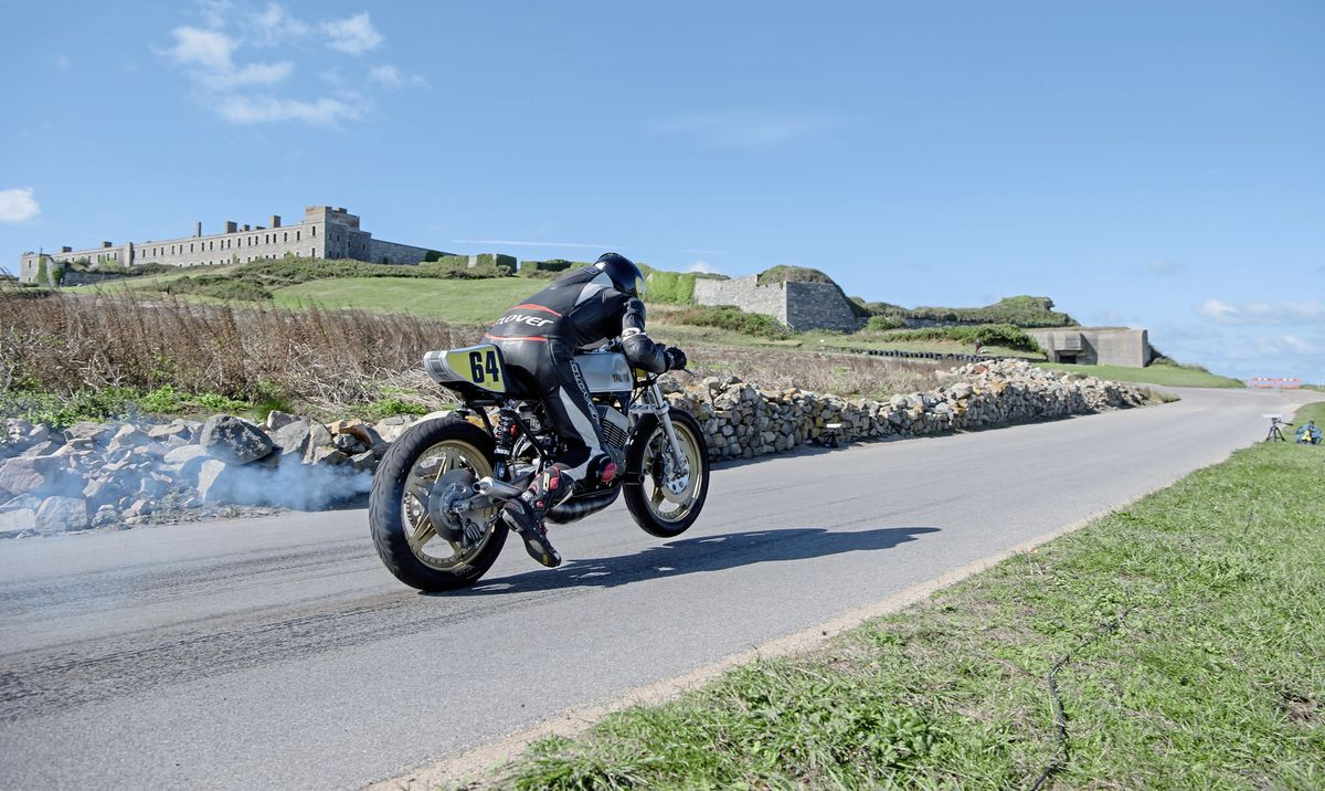 The place for pace: Andy Digard leaves the line at a previous Alderney weekend with Fort Tourgis in the background. (Picture by Andrew Le Poidevin, 29985054)