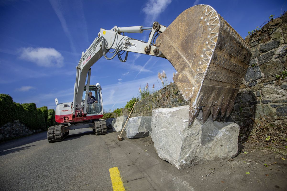 Roger Froome puts the last of the boulders in place with his digger. (Picture by Peter Frankland, 29998500)