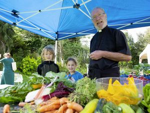 The Rev. Richard Bellinger, with helpers Josh and Rosa Lewis, on the vegetable stall at the Saumarez Manor farmers' market. The market is appealing for more stall holders as some have dropped out due to lockdowns. (Picture by Cassidy Jones, 29822252)