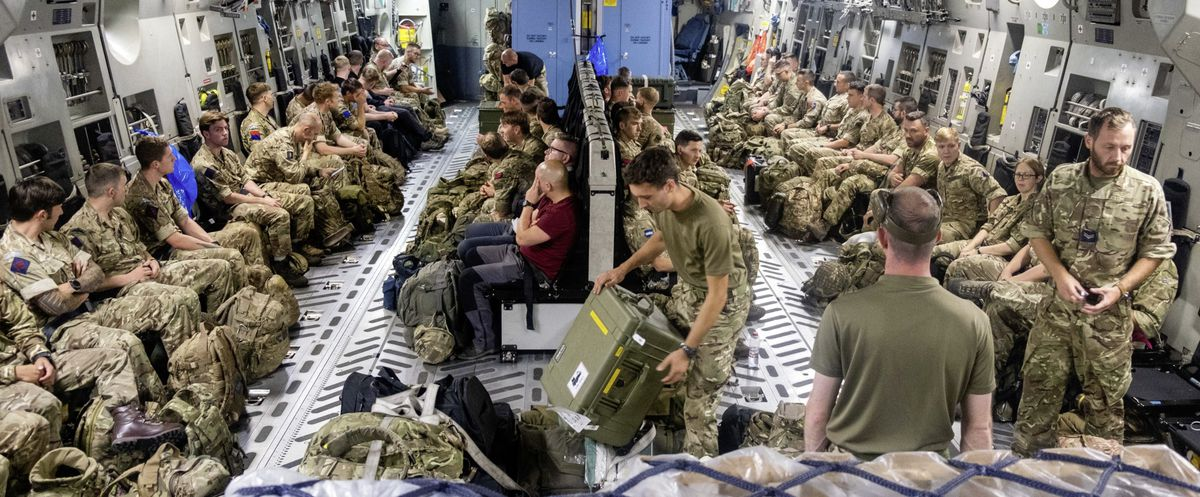 A Ministry of Defence photo showing members of Joint Forces Headquarters (JFHQ) deploying to Afghanistan to assist in the draw down of troops from the area.