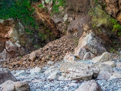 Caution urged after rockfalls