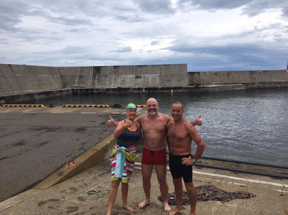 In 2017 Adrian Sarchet completed the sixth of the seven challenges, by crossing the Tsugaru Strait in Japan. His team has been by his side, supporting him through the challenges. Left to right: Mandy Mackelworth, Adrian Sarchet and Pete Rowland.