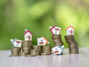 Mini house model and stack of coins. Business risk management. Property investment and house mortgage financial real estate concept. Business investment will increase Or bankrupt. (29567396)