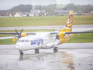 Picture by Sophie Rabey.  01-11-10.  New Aurigny ATR in action, arriving from Gatwick today.  Catching up with passengers on how they enjoyed the new aircraft. (26230482)
