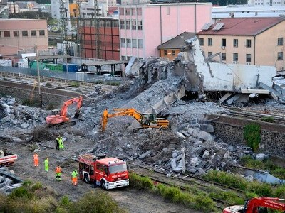 Heavy equipment brought in to move rubble from Genoa bridge collapse