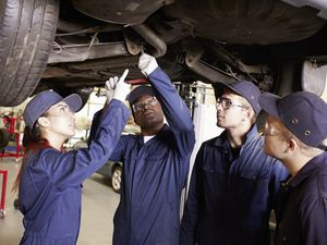 Apprentices learning motor mechanics. (Monkey Business Images/Shutterstock)