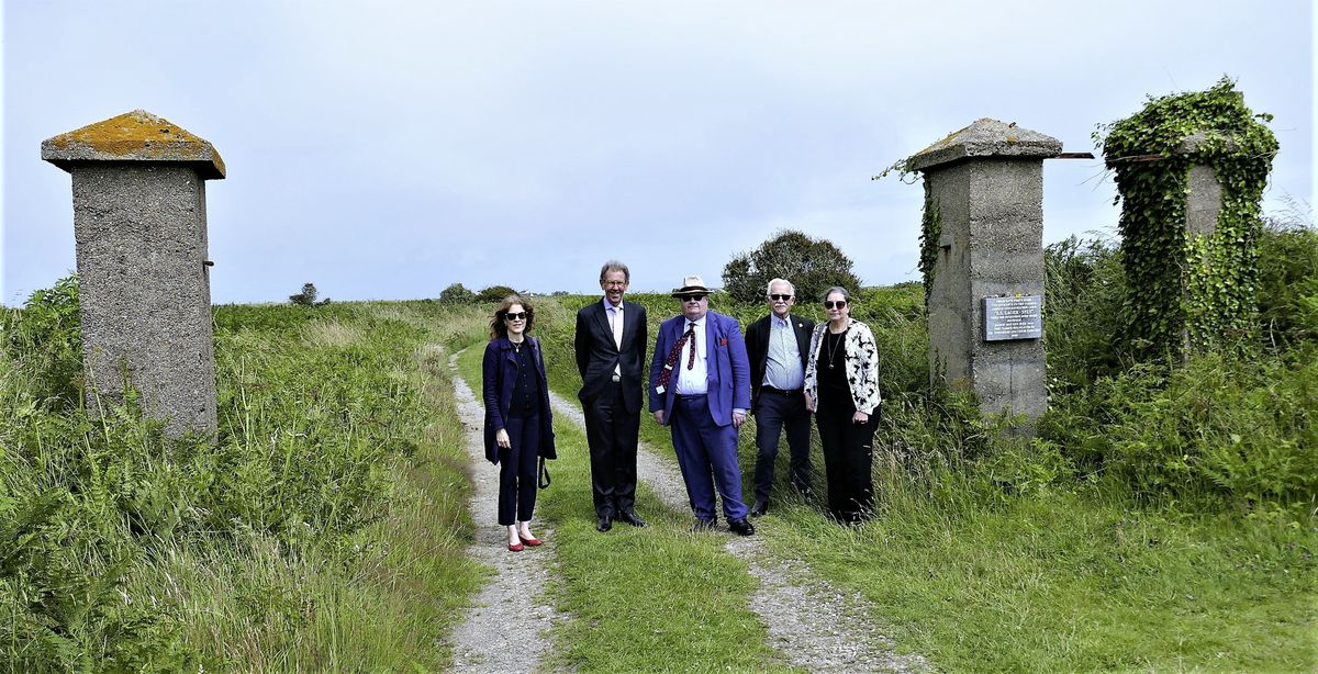The States of Alderney is to consult all of the island's households about plans to safeguard its Second World War heritage sites. Pictured at Sylt concentration camp are, left right, Gilly Carr, Alderney President William Tate, Lord Eric Pickles, Alderney States Member and chairman of the Policy and Finance committee Bill Abel, and Sally Sealey of the UK Holocaust Memorial Foundation. (Picture supplied by David Nash)