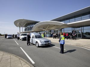 Fellow drivers and airport staff paid tribute to 'Taxi Sally' Falla when her funeral cortege stopped outside yesterday. (Picture by Cassidy Jones, 29388157)