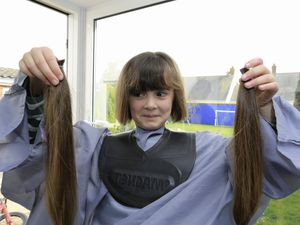 Beatrix Buchanan, 8, after stylist Tracy Gilheany had cut her foot-long hair. She donated it to The Little Princess Trust and also raised money for Care International for children in Yemen. (Pictures by Adrian Miller, 29393743)