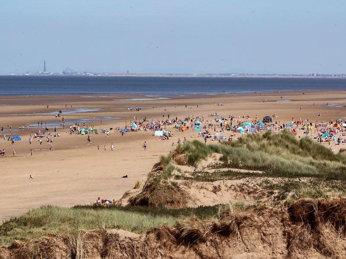 Three men injured in beach stabbing