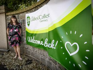 Ashley Clancy, the principal at The Ladies' College, alongside the welcome back banner as the school returned to lessons for the first time since being shut to combat the spread of the coronavirus.  (Picture by Peter Frankland, 28322526)