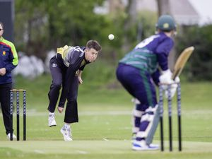Luke Bichard opens the bowling from the Rue a'lor end (29554976)