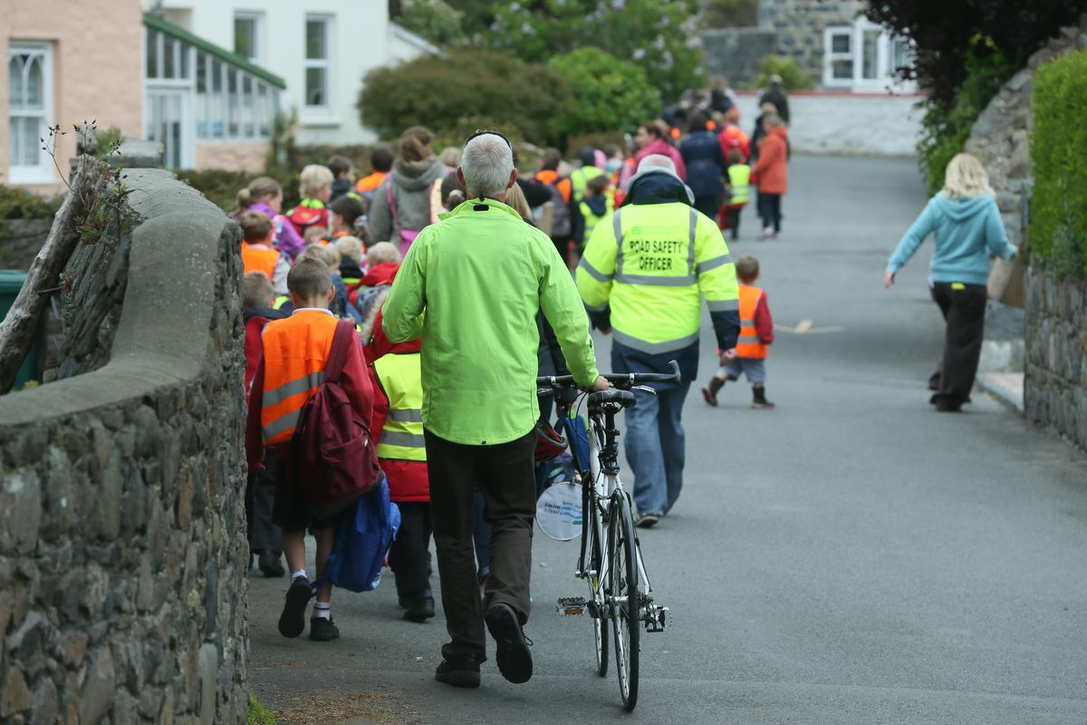 A walking bus for Vale Primary pupils from Bordeaux during a Walk To School Week. Inset, Be Active lead Alun Williams.(Picture by Adrian Miller, 28339116)