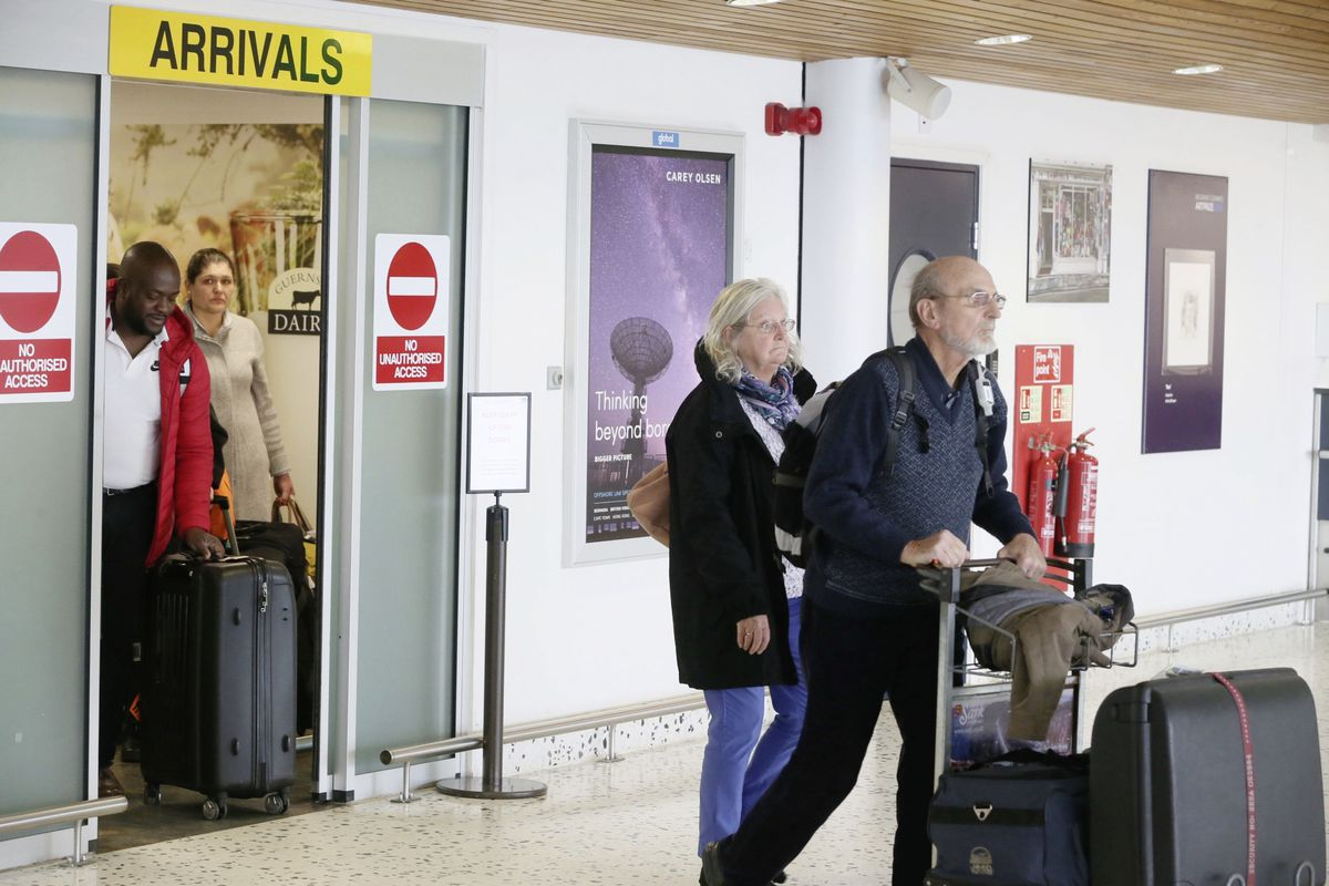 Pic by Adrian Miller 18-03-20 Airport vox pop passengers arriving back home from UK .. (27535410)