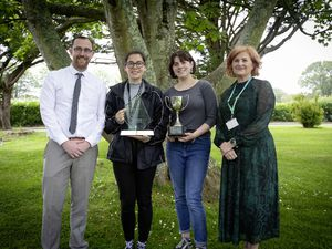 Jenny Naftel, overall student of the year, second right, with Guernsey College of Further Education principal Louise Misselke, and Elainer Laine, second left, winner of the Sovereign Group-sponsored award for the student who contributed most to the community or charity outside their studies, and Sovereign director Sean Gillease. (Pictures by Cassidy Jones, 29641126)