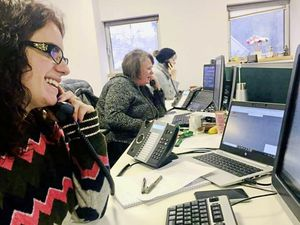 Call handlers at the mass vaccination programme call centre, which launched this weekend and is open from 8am until 8pm weekdays and 8am until noon on weekends. Image by the States of Guernsey. (29120480)